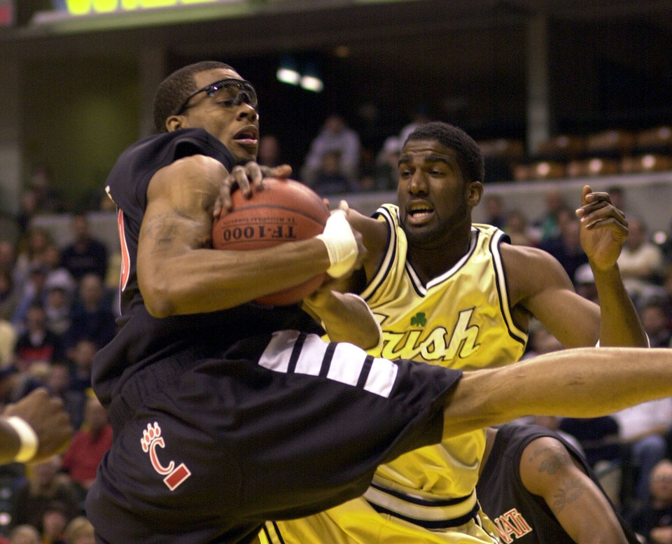 Cincinnati basketball player Donald Little, left, grabs a rebound from Notre Dame\'s Ryan Humphrey during first half of the John Wooden Tradition at Conseco Fieldhouse in Indianapolis Saturday, Nov. 25, 2000. (AP Photo/Tom Strickland)