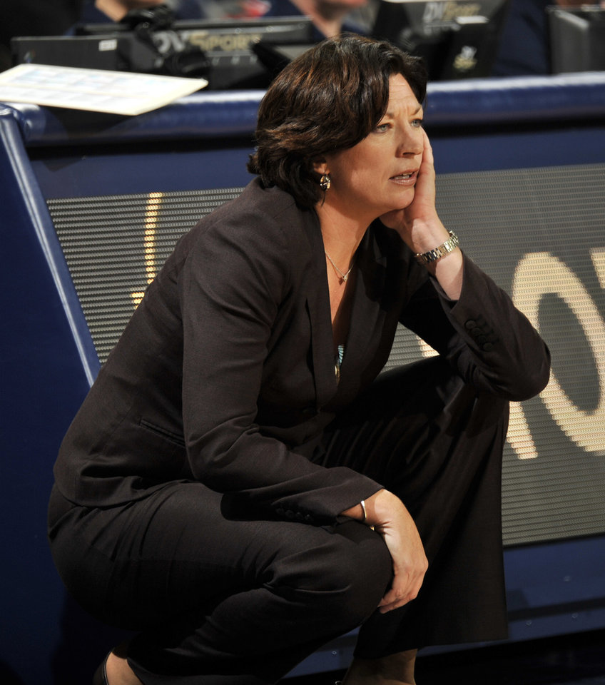 Photo - Miami coach Katie Meier watches her team during the first of an NCAA college basketball game against Notre Dame, Thursday, Jan. 23, 2014 in South Bend, Ind. (AP Photo/Joe Raymond)