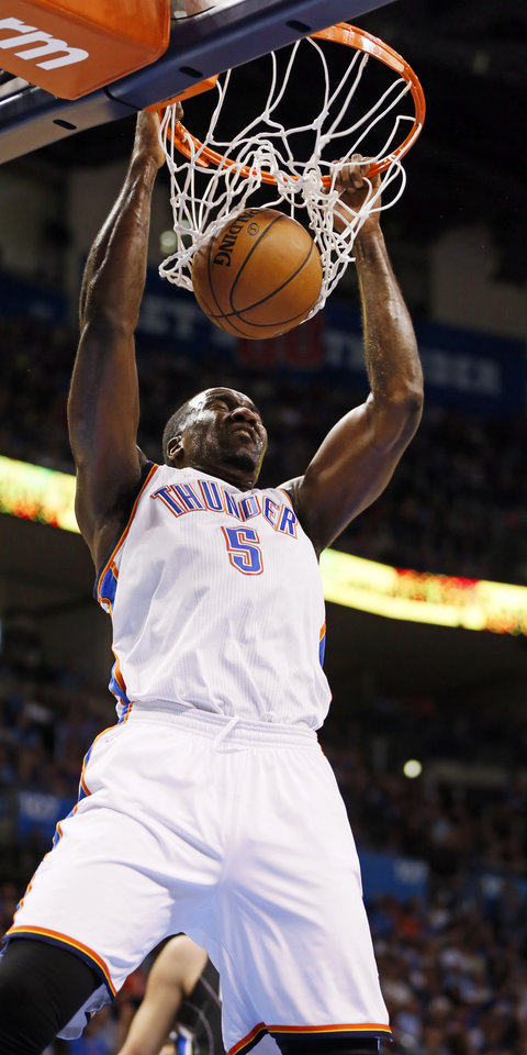 Photo - Oklahoma City's Kendrick Perkins (5) dunks the ball during an NBA basketball game between the Oklahoma City Thunder and the Orlando Magic at Chesapeake Energy Arena in Oklahoma City, Friday, March 15, 2013. Photo by Nate Billings, The Oklahoman
