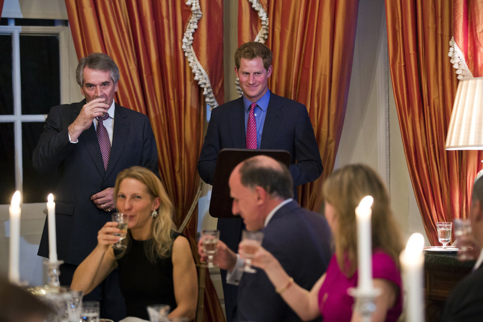 Photo - British Ambassador Sir Peter Westmacott toasts Britain's Prince Harry at a dinner at the Ambassador's residence in Washington, Thursday, May 9, 2013. (AP Photo/Jim Lo Scalzo, Pool)