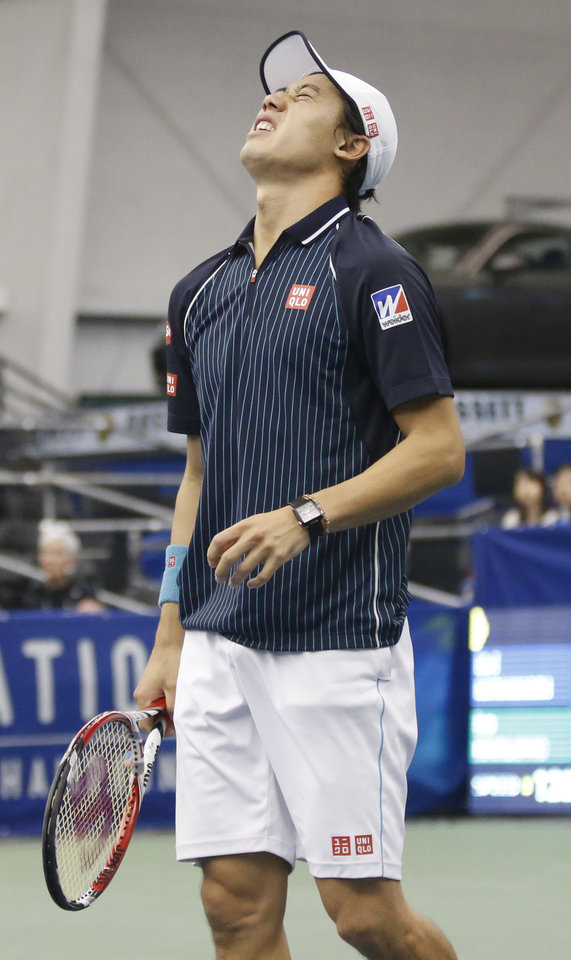 Photo - Kei Nishikori, of Japan, reacts after his return to Ivo Karlovic, of Croatia, in the singles final at the U.S. National Indoor Tennis Championships, Sunday, Feb. 16, 2014, in Memphis, Tenn. (AP Photo/Rogelio V. Solis)