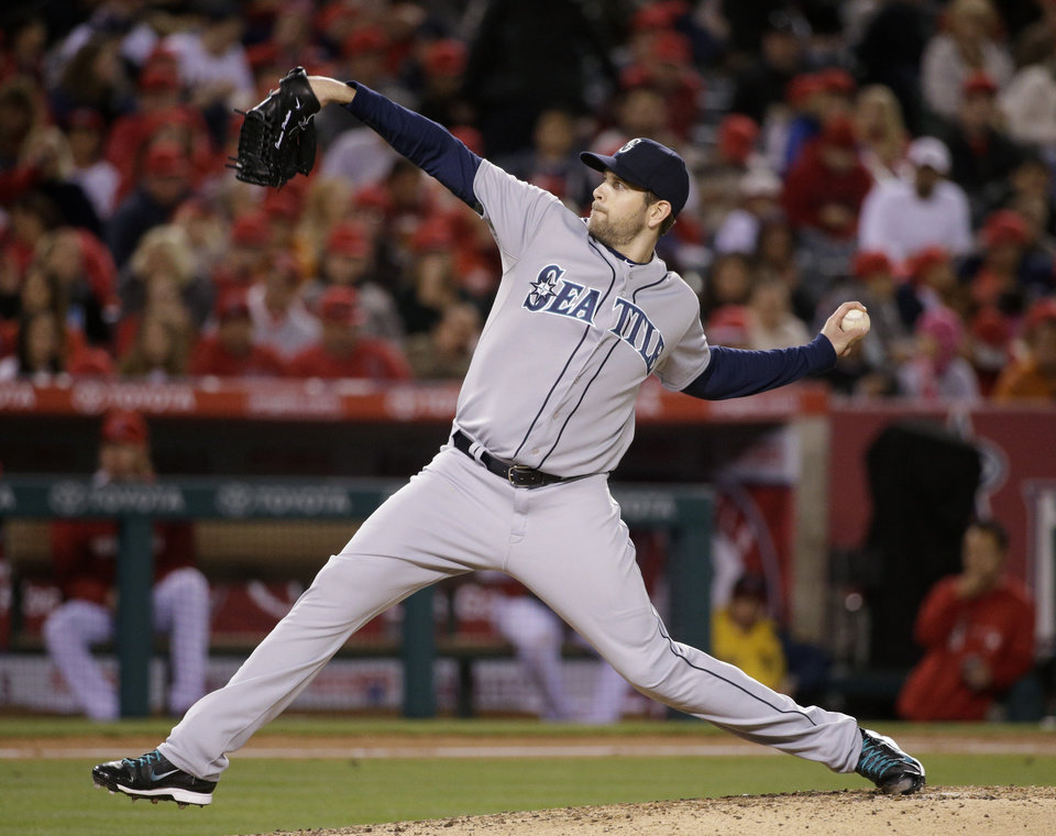 Photo - Seattle Mariners starting pitcher James Paxton throws to a Los Angeles Angels batter during the fourth inning of a baseball game Wednesday, April 2, 2014, in Anaheim, Calif. (AP Photo/Jae C. Hong)