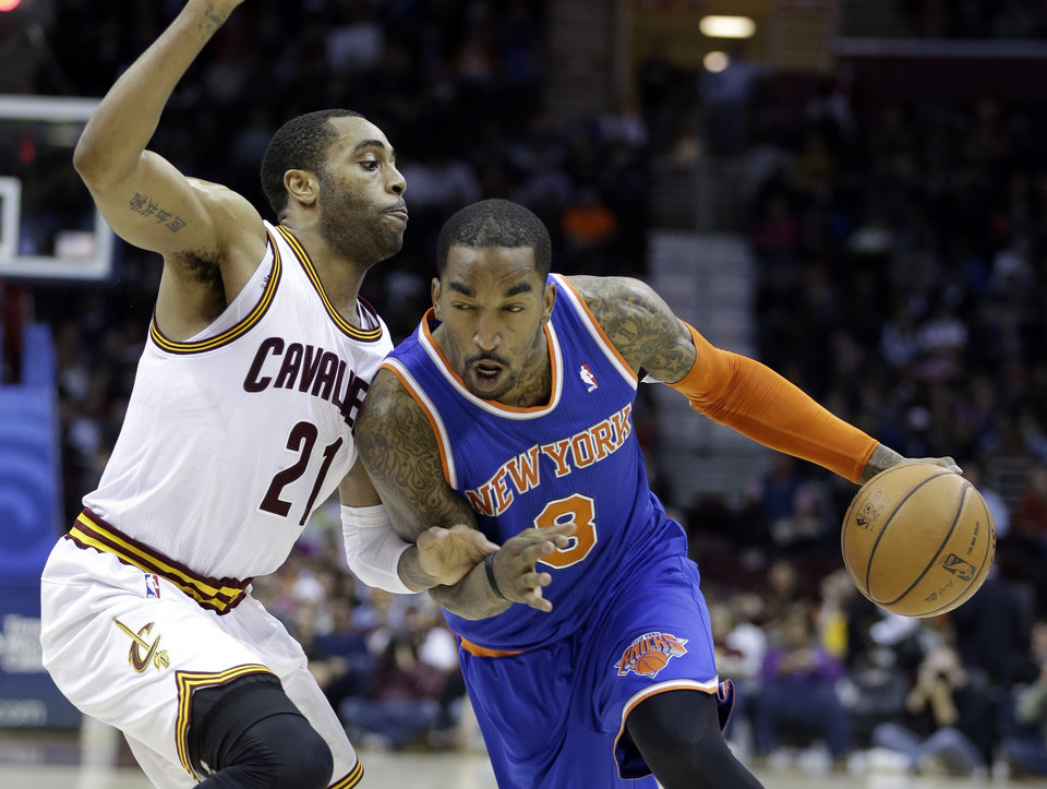 New York Knicks' J.R. Smith (8) drives past Cleveland Cavaliers' Wayne Ellington (21) in the third quarter of an NBA basketball game on Friday, April 12, 2013, in Cleveland. Smith scored 31 points in the Knicks' 101-91 win. (AP Photo/Mark Duncan) ORG XMIT: CDA110
