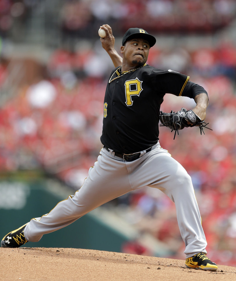 Photo - Pittsburgh Pirates starting pitcher Edinson Volquez throws during the first inning of a baseball game against the St. Louis Cardinals, Sunday, April 27, 2014, in St. Louis. (AP Photo/Jeff Roberson)