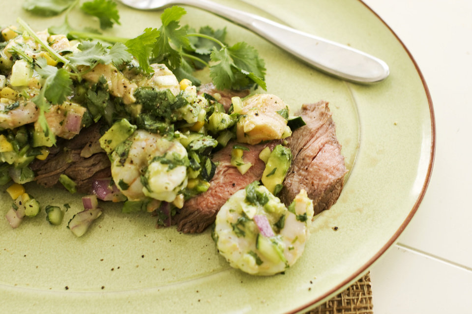 Pepper-lime flank steak with shrimp and salmon ceviche. AP Photo <strong>Matthew Mead - AP</strong>