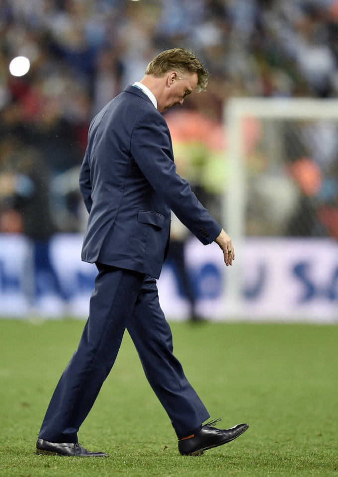 Photo - Netherlands' head coach Louis van Gaal walks off the pitch after a shootout at the end of the World Cup semifinal soccer match between the Netherlands and Argentina at the Itaquerao Stadium in Sao Paulo Brazil, Wednesday, July 9, 2014. Argentina won 4-2 on penalties after the match ended 0-0 after extra time.  (AP Photo/Martin Meissner)