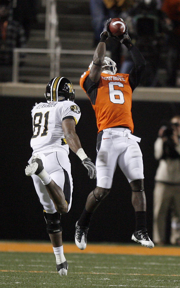 Photo - OSU's Andrew McGee (6) intercepts a pass intended for Missouri's Danario Alexander (81) during the college football game between Oklahoma State University (OSU) and the University of Missouri (MU) at Boone Pickens Stadium in Stillwater, Okla. Saturday, Oct. 17, 2009.  Photo by Sarah Phipps, The Oklahoman