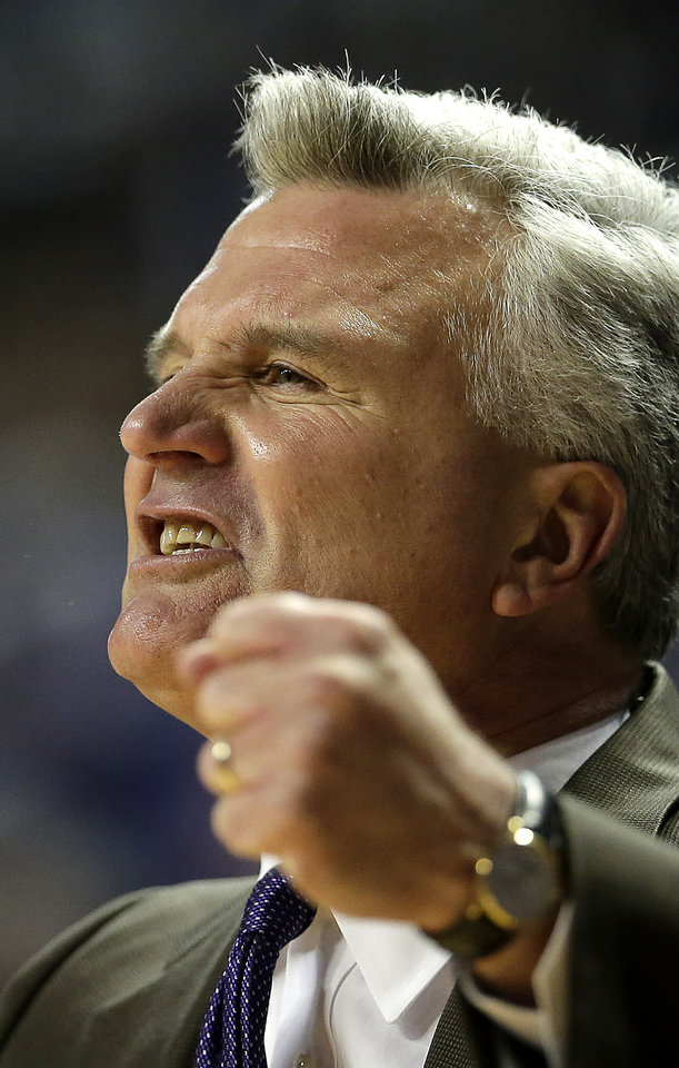Photo - Kansas State coach Bruce Weber talks to his players during the first half of an NCAA college basketball game against Iowa State Saturday, March 1, 2014, in Manhattan, Kan. Kansas State won the game 80-73. (AP Photo/Charlie Riedel)
