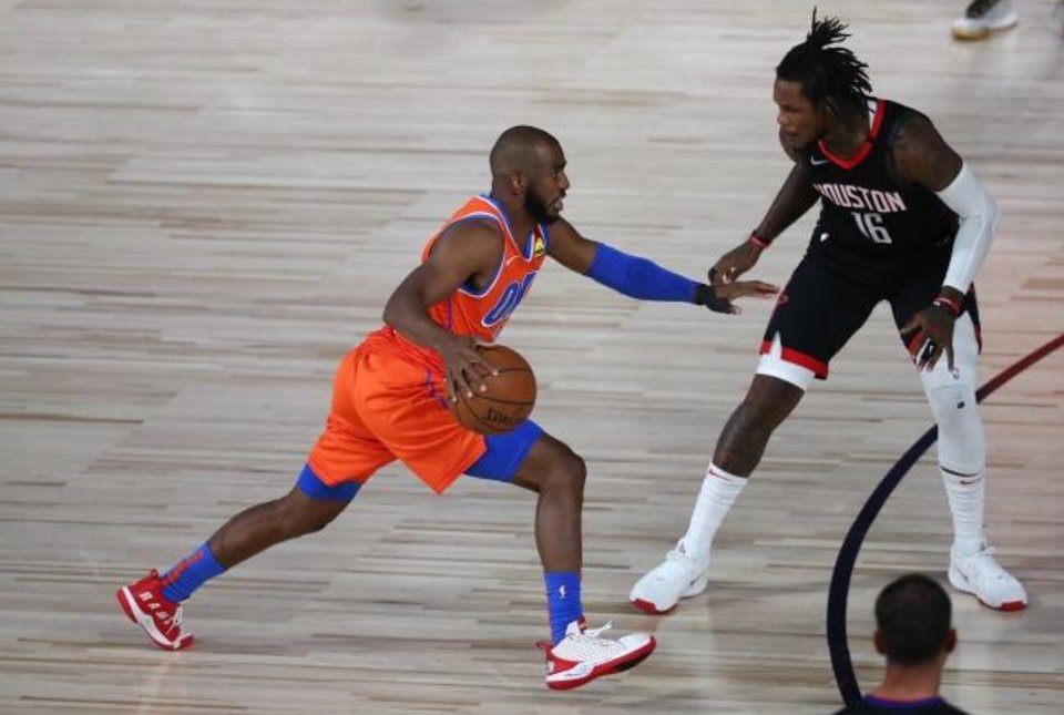 Photo -  Aug 18, 2020; Lake Buena Vista, Florida, USA; Oklahoma City Thunder guard Chris Paul (3) drives against Houston Rockets forward Ben McLemore (16) in the first half in game one of the first round of the 2020 NBA Playoffs at The Field House. Mandatory Credit: Kim Klement-USA TODAY Sports