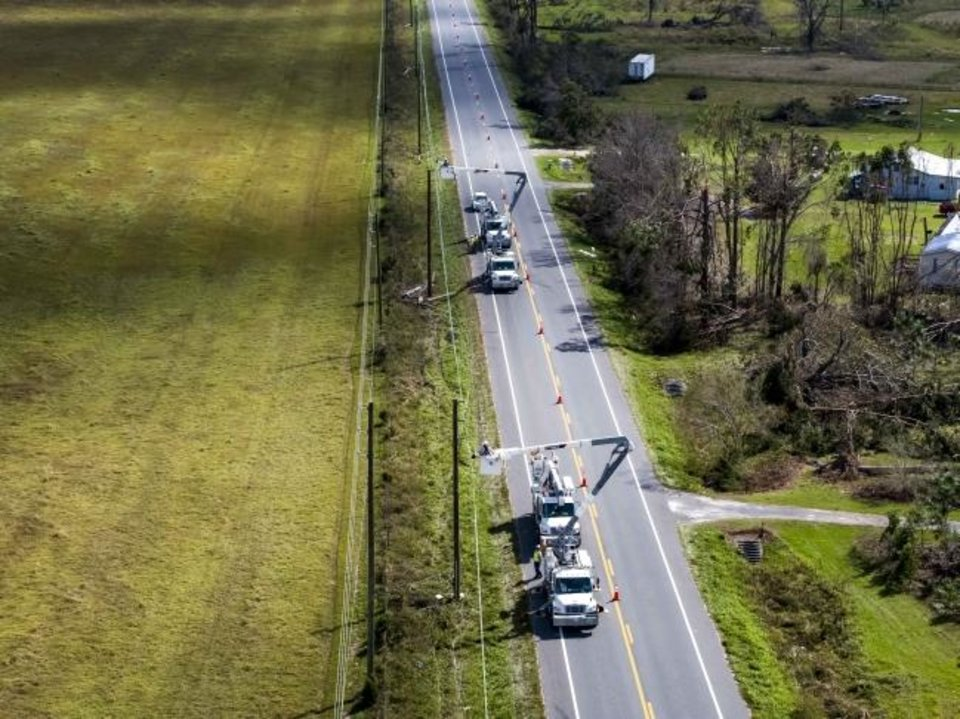 Photo -  Florida Power and Light crews work to restore power to customers  after Hurricane Michael in 2018. [PROVIDED BY FLORIDA POWER AND LIGHT]