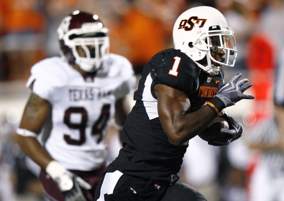 Photo - OSU's Joseph Randle scores a touchdown as A&M Damontre Moore chases him down during the college football game between Texas A&M University (TAMU) and Oklahoma State University (OSU) at Boone Pickens Stadium in Stillwater, Okla., Thursday, Sept. 30, 2010. Photo by Sarah Phipps, The Oklahoman