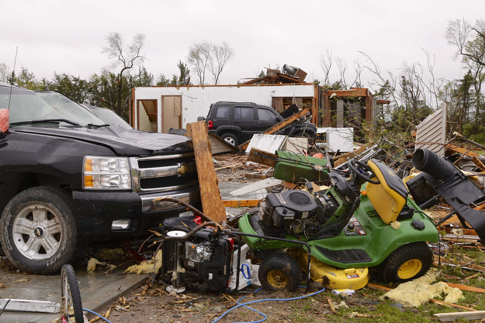 Photo - Smashed cars and belongings litter the surroundings of a house in Cordova, Neb., Monday, May 12, 2014, after several tornadoes moved across Nebraska on Sunday causing damage to homes and businesses in or near Sutton, Garland, Cordova and Daykin. The storms also left more than 18,000 utility customers without electricity. (AP Photo/Nati Harnik)