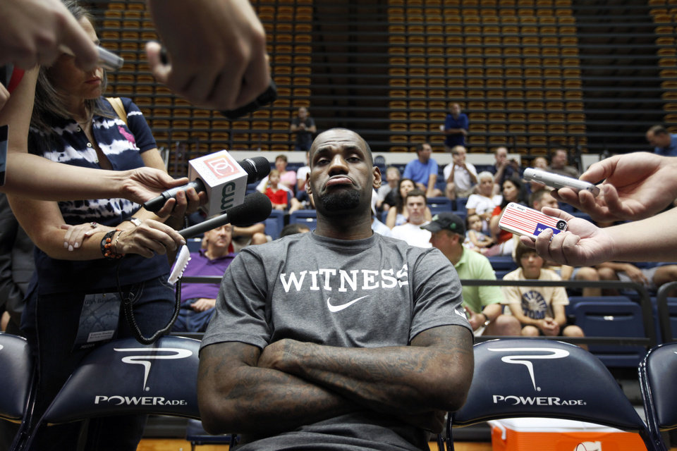 Photo -   U.S. men's national basketball team forward LeBron James pauses during a media availability before a practice Sunday, July 15, 2012, in Washington. (AP Photo/Alex Brandon)
