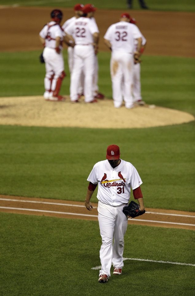 Photo - St. Louis Cardinals starting pitcher Lance Lynn, bottom, walks off the field after being removed from a baseball game during the seventh inning against the Tampa Bay Rays, Wednesday, July 23, 2014, in St. Louis. (AP Photo/Jeff Roberson)