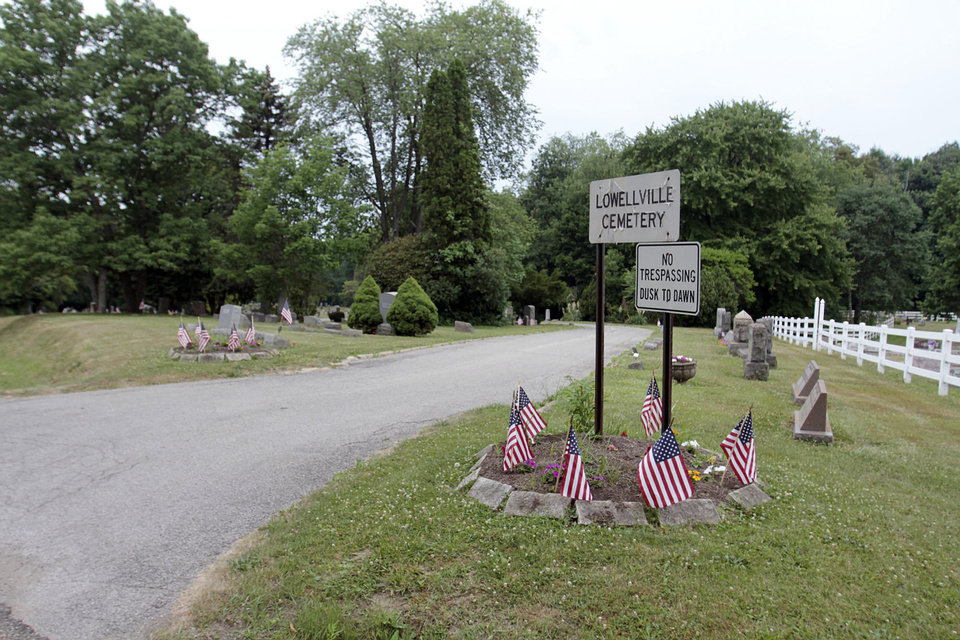 Photo - The entrance to the cemetery in Lowellville, Ohio is shown.  AP Photo