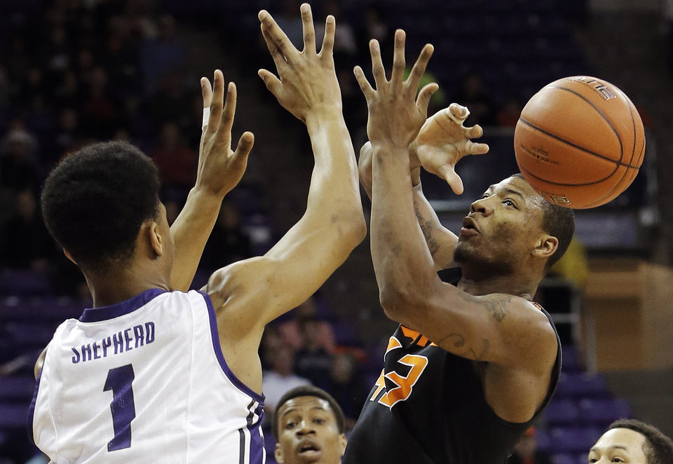 Photo - TCU's Karviar Shepherd (1) forces Oklahoma State guard Marcus Smart (43) to loose control of the ball in the first half of an NCAA college basketball game, Monday, Feb. 24, 2014, in Fort Worth, Texas. (AP Photo/Brandon Wade)