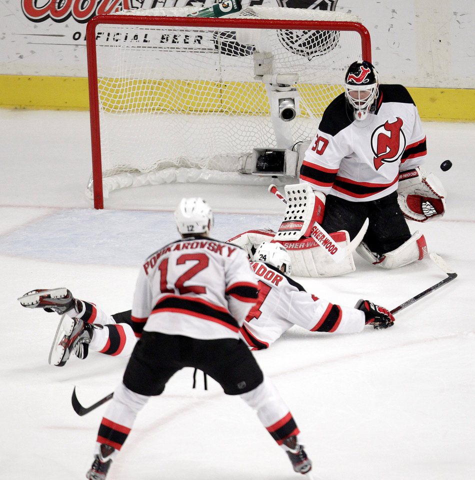 Photo -   New Jersey Devils goalie Martin Brodeur makes a save against the New York Rangers during the second period of Game 5 of an NHL hockey Stanley Cup Eastern Conference final playoff series, Wednesday, May 23, 2012, in New York. (AP Photo/Julio Cortez)