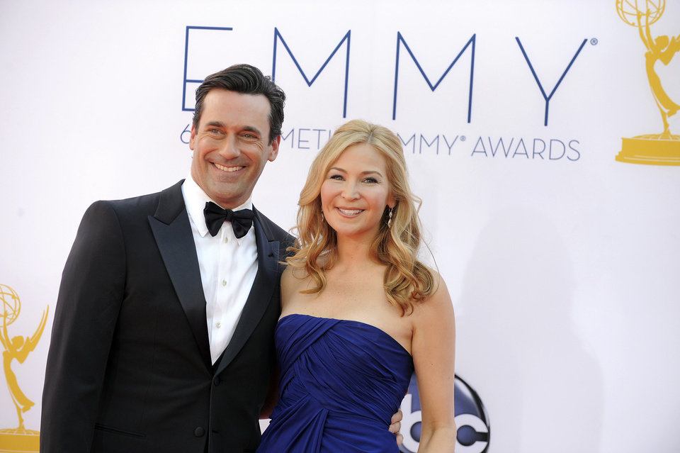 Photo -   Jon Hamm, left and Jennifer Westfeldt arrive at the 64th Primetime Emmy Awards at the Nokia Theatre on Sunday, Sept. 23, 2012, in Los Angeles. (Photo by Jordan Strauss/Invision/AP)