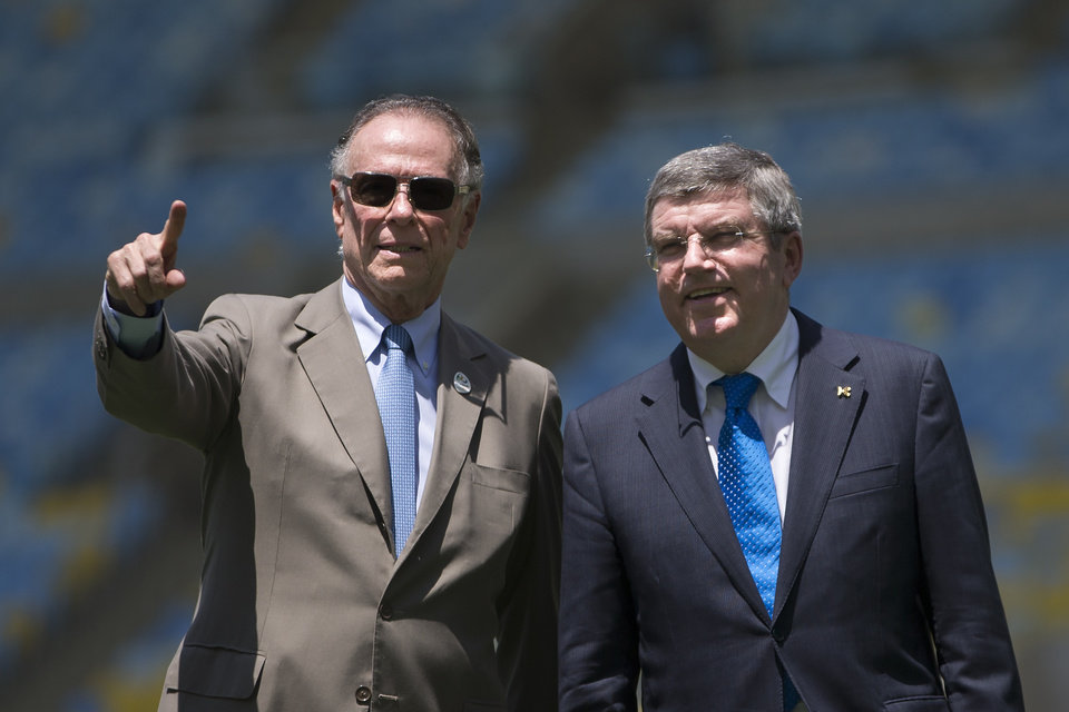 Photo - International Olympic Committee (IOC) President Thomas Bach, right, and President of Brazil's Olympic Committee Carlos Arthur Nuzman visit Maracana stadium in Rio de Janeiro, Brazil, Wednesday, Jan. 22, 2014. The city of Rio de Janeiro will host the Olympics in 2016. (AP Photo/Felipe Dana)