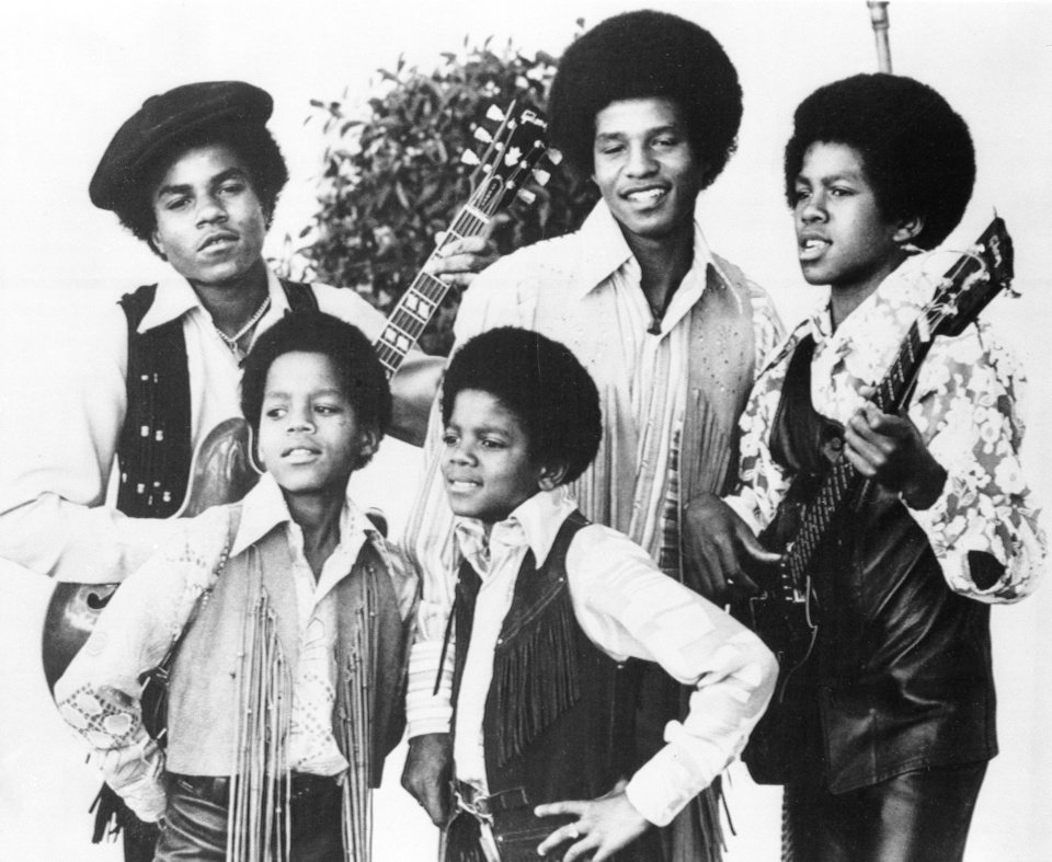 Photo - FILE - In this undated file photo, the Jackson 5, Michael Jackson, front right, Marlon Jackson, front left, Tito Jackson, back left, Jackie Jackson and Jermaine, back right, are shown in Los Angeles.  (AP Photo, file) ORG XMIT: NYET703