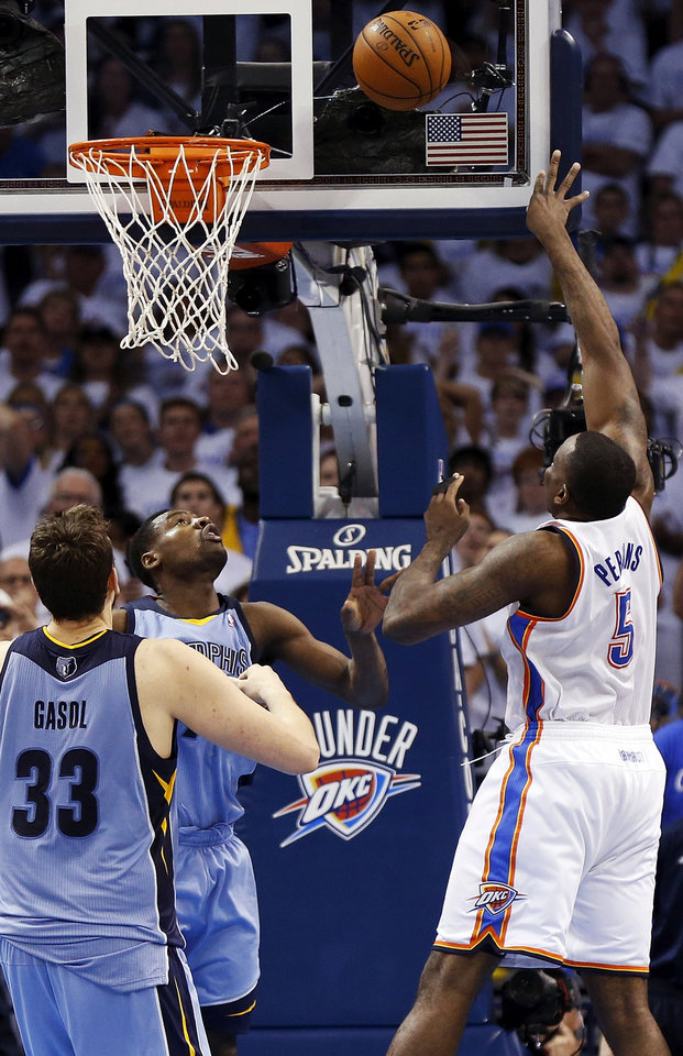 Photo - Oklahoma City's Kendrick Perkins (5) takes the shot that sends the game to overtime against Memphis' Marc Gasol (33) and Tony Allen (9) during Game 2 in the first round of the NBA playoffs between the Oklahoma City Thunder and the Memphis Grizzlies at Chesapeake Energy Arena in Oklahoma City, Monday, April 21, 2014. Memphis won 111-105 in overtime. Photo by Nate Billings, The Oklahoman