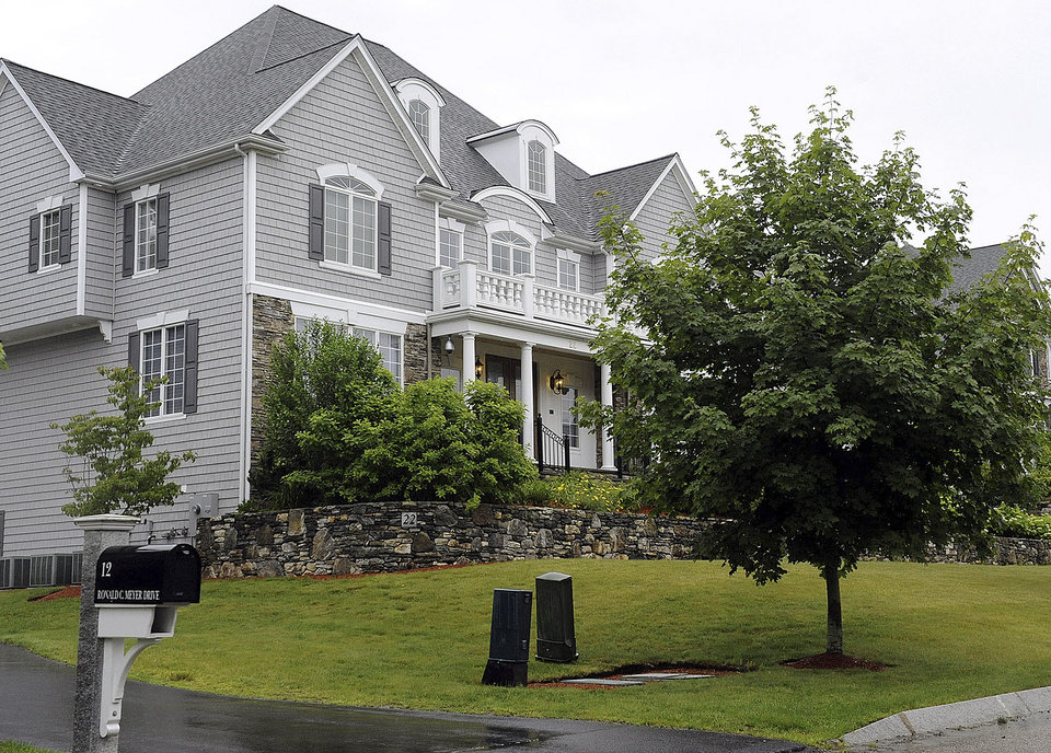 Photo - This Tuesday, June 18, 2013 photo shows the home of New England Patriot's NFL football player Aaron Hernandez in North Attleborough, Mass. State and local police spent hours at the home Tuesday as another group of officers searched an industrial park about a mile away where a body was discovered the day before.  (AP Photo/The Sun Chronicle, Martin Gavin)