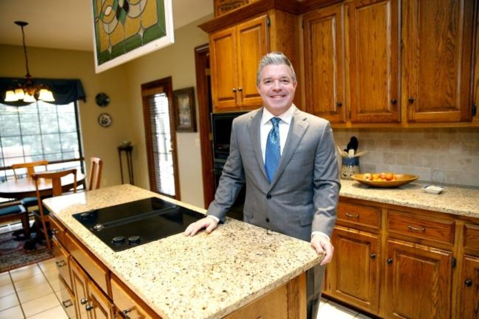 Photo -  Realtor Nick Hilton, of RE/MAX Preferred, stands in the kitchen of a home he has listed for sale at 2301 Powderhorn in Edmond. He was voted Most Cooperative Realtor for 2018 by the Oklahoma City Metro Association of Realtors.  [SARAH PHIPPS/THE OKLAHOMAN]