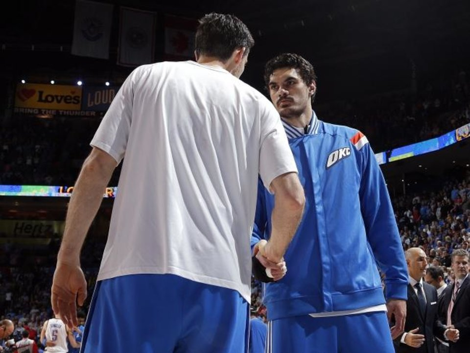 Photo -  Oklahoma City's Steven Adams (12) and Nick Collison (4) shake hands before a game against the Clippers on March 11, 2015, at Chesapeake Energy Arena. [Sarah Phipps/The Oklahoman]