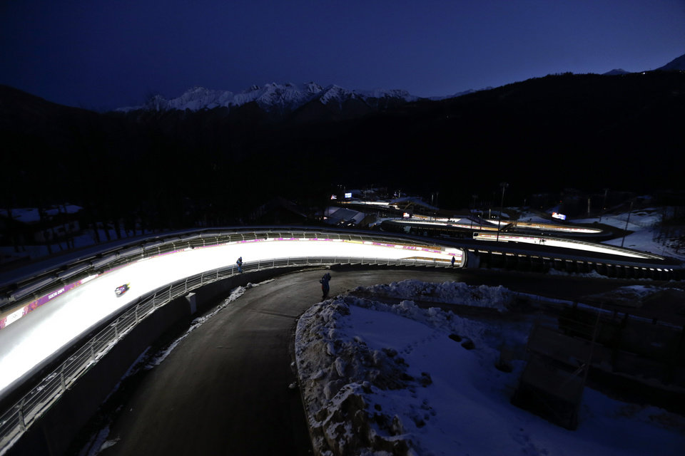 Photo - David Moeller of Germany takes a turn during a training session for the men's singles luge at the 2014 Winter Olympics, Friday, Feb. 7, 2014, in Krasnaya Polyana, Russia. (AP Photo/Natacha Pisarenko)