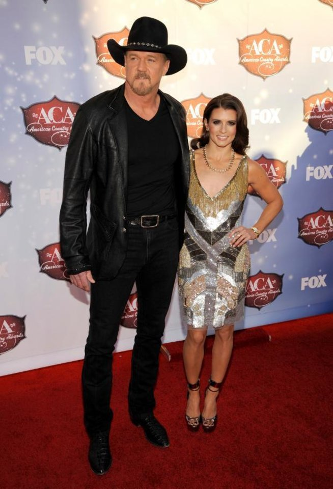 Photo -  Trace Adkins and Danica Patrick arrive at the ACAs. (AP)