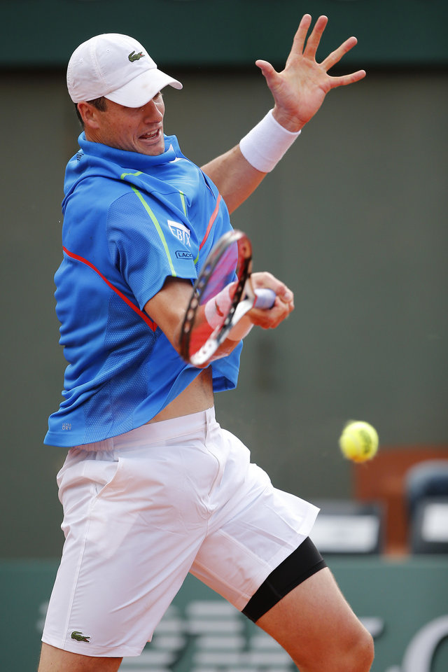 Photo - John Isner of the U.S. returns the ball during the third round match of the French Open tennis tournament against Spain's Tommy Robredo at the Roland Garros stadium, in Paris, France, Friday, May 30, 2014. Isner won in four sets 7-6, 7-6, 6-7, 7-5. (AP Photo/David Vincent)