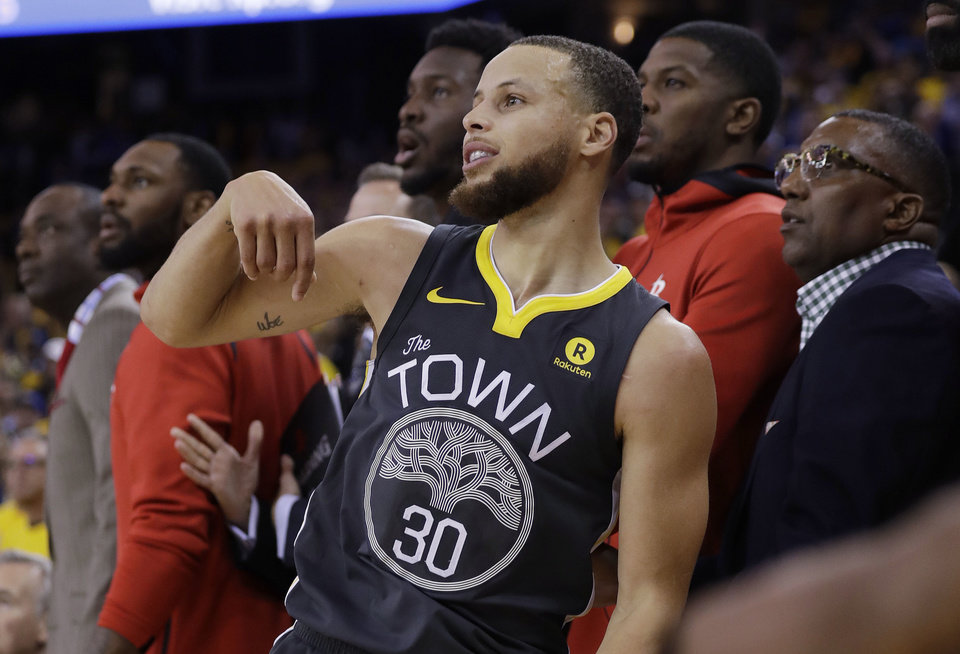 Stephen Curry watches as he misses the last shot at the buzzer in in the Warriors 95-92 loss to the Houston Rockets in Game 4 of the NBA basketball Western Conference Finals on Tuesday in Oakland Calif. Game 5 is Thursday in Houst