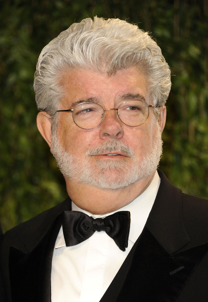 Photo -   FILE - In this Feb. 26, 2012 file photo, George Lucas arrives at the Vanity Fair Oscar party in West Hollywood, Calif. A decade after George Lucas said