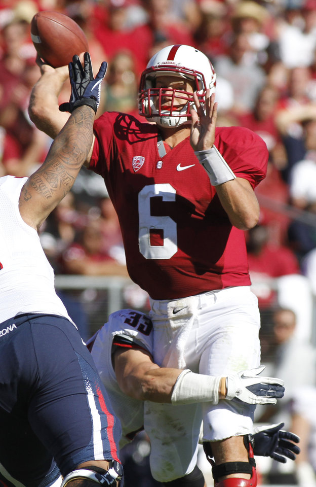 Stanford quarterback Josh Nunes throws under pressure from Arizona during the second half of an NCAA college football game in Stanford, Calif., Saturday, Oct. 6, 2012. (AP Photo/George Nikitin)