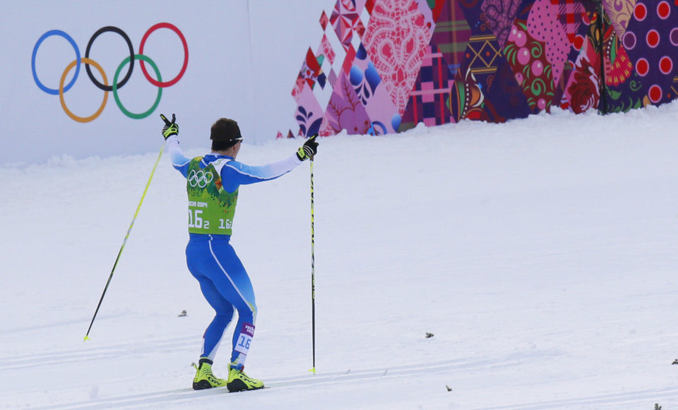 Photo - Finland's Sami Jauhojaervi celebrates winning the gold during the men's classical-style cross-country team sprint competitions at the 2014 Winter Olympics, Wednesday, Feb. 19, 2014, in Krasnaya Polyana, Russia. (AP Photo/Dmitry Lovetsky)