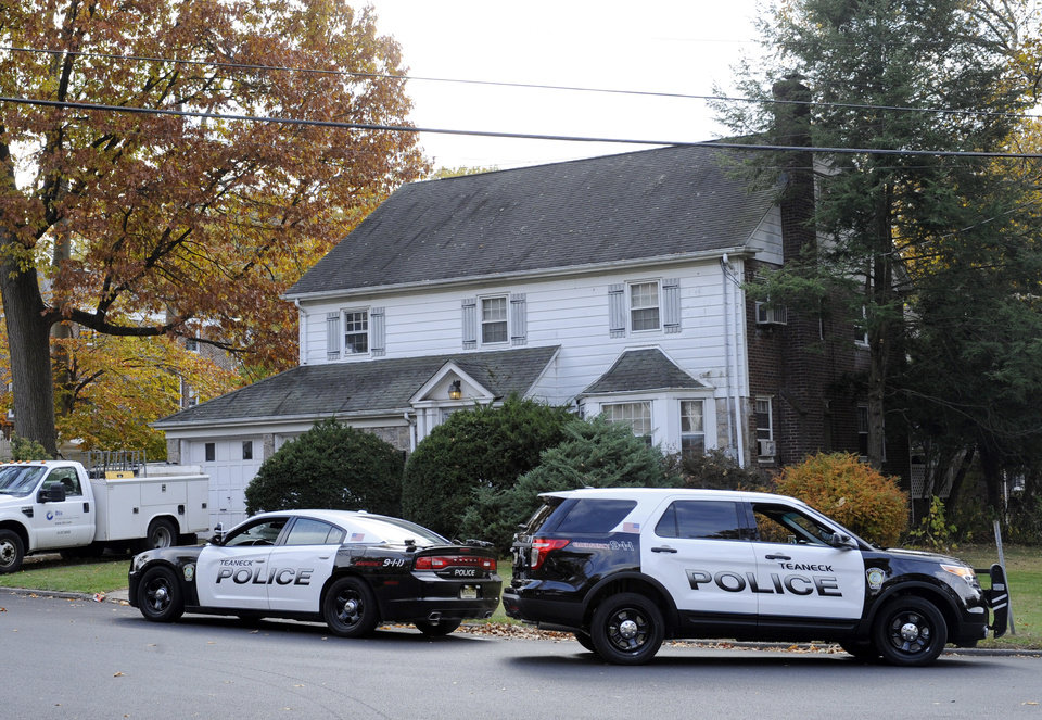 Photo - Police cars are parked outside the house where Richard Shoop lived in Teaneck, N.J. Tuesday, Nov. 5, 2013. Richard Shoop is the 20-year-old gunman who fired multiple shots at at the Garden State Plaza Monday evening, Nov. 4. He was found dead Tuesday of of a self-inflicted wound, authorities said. There were no other injuries.  (AP Photo/Bill Kostroun)