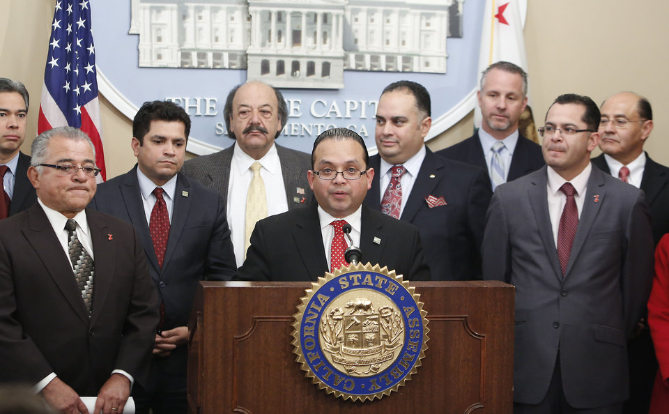Photo - Assemblyman Luis Alejo, D-Watsonville,  center, discusses his proposed joint resolution calling on the president and Congress to improve the nation's immigration system during a news conference, at the Capitol Sacramento, Calif., Thursday, Jan. 231, 2013.  State demographers predict that  Hispanics will become the dominant ethnic group in California for the fist time in 2014.  Alejo was accompanied by, from left, Assembly members Rocky Chavez, R-Carlsbad,  Jimmy Gomez, D-Los Angeles, Katcho Achadjian, R-San Luis Obispo, Assembly Speaker John Perez, D-Los Angeles, Sen. Anthony Cannella, R-Ceres, Assemblyman Manuel Perez, D-Coachella and Sen. Lou Correa, D-Anaheim, right. (AP Photo/Rich Pedroncelli)