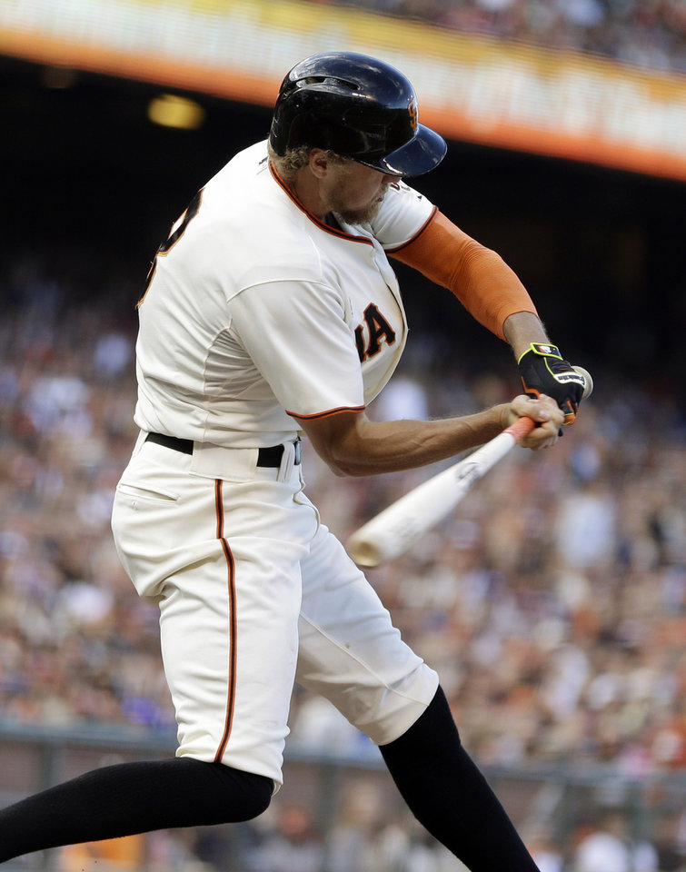 Photo - San Francisco Giants' Hunter Pence swings for an RBI single off Los Angeles Dodgers' Hyun-Jin Ryu in the third inning of a baseball game Sunday, July 27, 2014, in San Francisco. (AP Photo/Ben Margot)