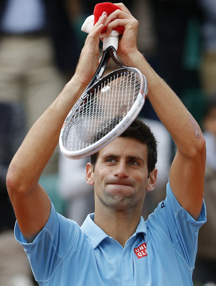 Photo - Serbia's Novak Djokovic waves after defeating Croatia's Marin Cilic during their third round match of  the French Open tennis tournament at the Roland Garros stadium, in Paris, France, Friday, May 30, 2014. Djokovic won 6-3, 6-, 6-7, 6-4. (AP Photo/Michel Spingler)