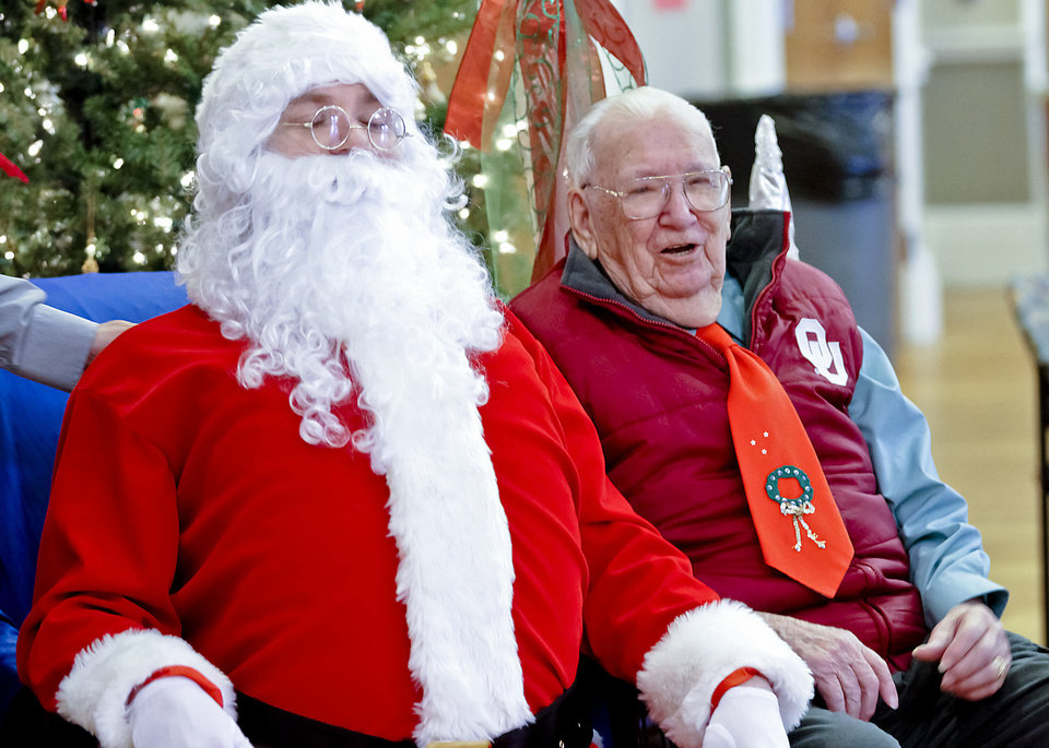 Gifford Parkhurst, 95, poses with Santa at the Edmond Senior Center. Photo by Chris Landsberger, The Oklahoman <strong>CHRIS LANDSBERGER - CHRIS LANDSBERGER</strong>