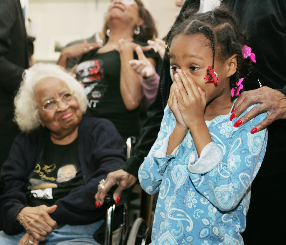 Photo - Civil rights pioneer Clara Luper, her daughter Marilyn Hildreth and 9 year-old Alexia Grant react to the Inauguration of President Barack Obama. Luper was watching TV at the Freedom Center at NE 26th and Martin Luther King Blvd. in Oklahoma City. January  20, 2009.  BY STEVE GOOCH, THE  OKLAHOMAN.
