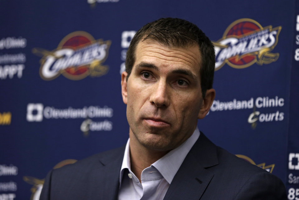 Photo - Cleveland Cavaliers general manager Chris Grant talks to the media about the firing of head coach Byron Scott at a news conference Thursday, April 18, 2013, in Independence, Ohio.  The Cleveland Cavaliers fired Scott after three losing seasons. (AP Photo/Tony Dejak)