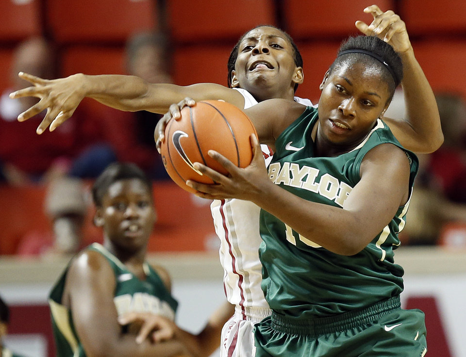 Photo - Oklahoma's Sharane Campbell (24) tries to intercept a pass caught by Baylor's Destiny Williams (10) during a women's college basketball game between the University of Oklahoma (OU) and Baylor at the Lloyd Noble Center in Norman, Okla., Monday, Feb. 25, 2013. Photo by Nate Billings, The Oklahoman