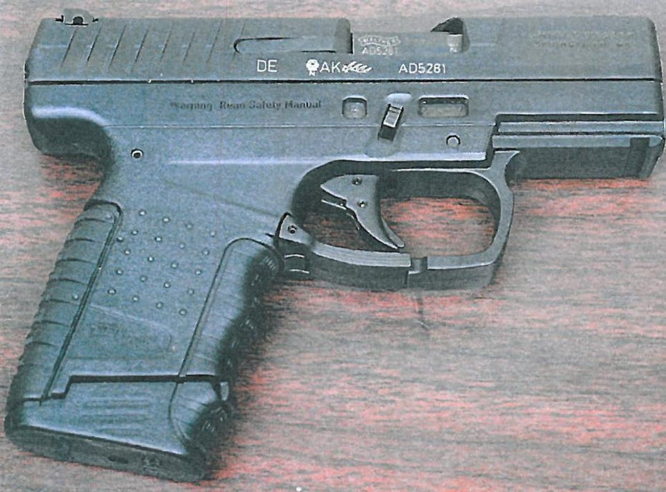 Photo - Police say Alan Hruby used this pistol stolen from his father to kill his parents and sister in October 2014.