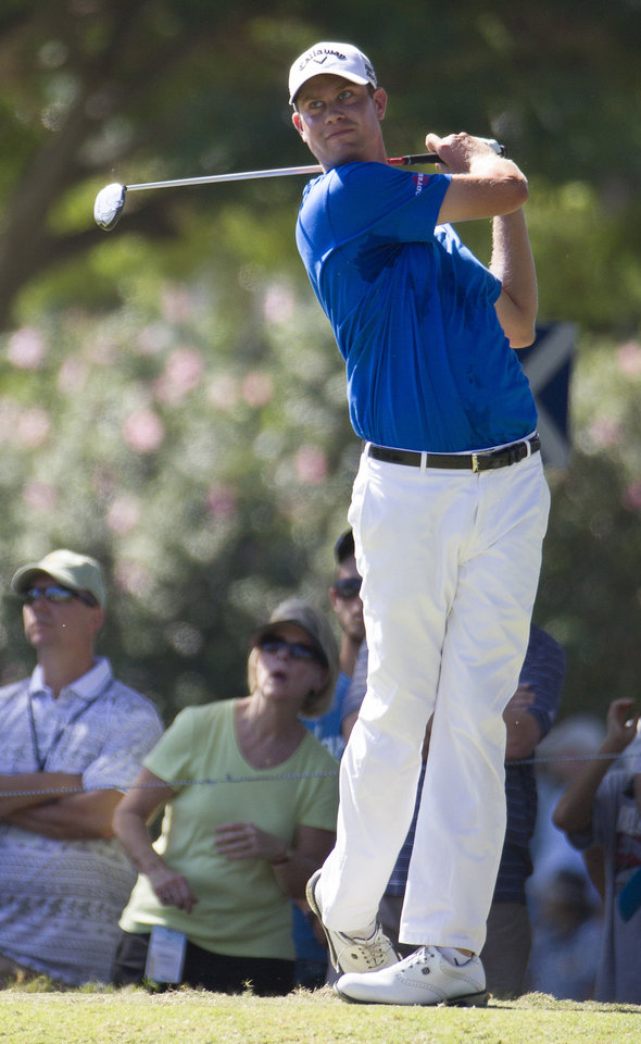 Photo - Harris English watches his drive off the second tee during the fourth round of the Sony Open golf tournament at Waialae Country Club, Sunday, Jan. 12, 2014, in Honolulu. (AP Photo/Eugene Tanner)