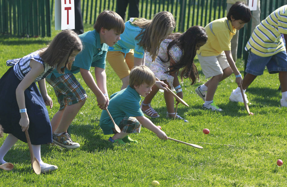 Children roll Easter eggs at the White House Easter Egg Roll hosted by President Barack Obama and first lady Michelle Obama, Monday, April 25, 2011, on the South Lawn of the White House in Washington. (AP Photo/Charles Dharapak)