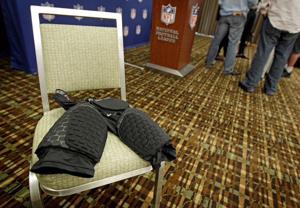 Photo -   A sample of the new thigh pads the NFL made mandatory equipment for the 2013 season are displayed following a news conference at an owners meeting Tuesday, May 22, 2012, in Atlanta. (AP Photo/David Goldman)