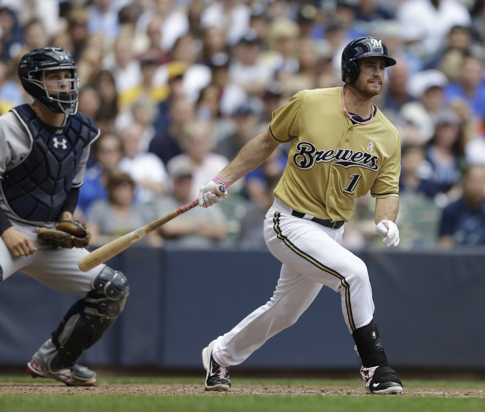 Photo - Milwaukee Brewers' Logan Schafer watches his run-scoring single against the New York Yankees during the sixth inning of a baseball game Sunday, May 11, 2014, in Milwaukee. (AP Photo/Jeffrey Phelps)