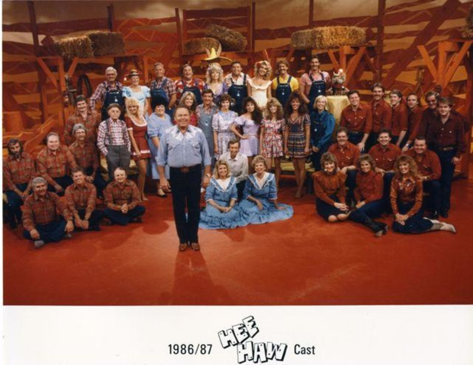 "Tulsa resident Roy Clark, center, and the rest of the 1986-87 ""Hee Haw"" cast pose for a photo. The Oklahoma History Center is giving a ""salute!"" to the long-running country variety show with the new exhibition ""Pickin' and Grinnin': Roy Clark, 'Hee Haw' & Country Humor."" Photo provided by the Oklahoma History Center."