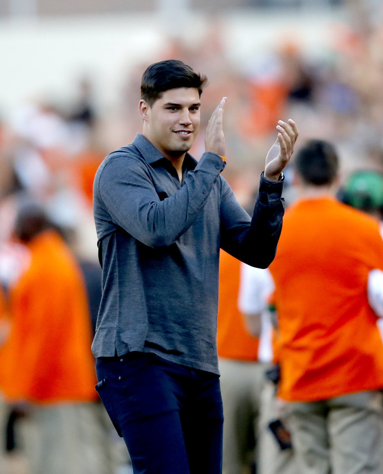 Photo - Mason Rudolph pumps up the crowd during the college football game between Oklahoma State University and Baylor at Boone Pickens Stadium in Stillwater, Okla., Saturday, Oct. 19, 2019. Baylor won 45-27. [Sarah Phipps/The Oklahoman]